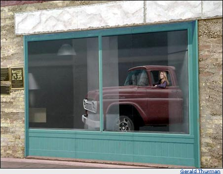 Girl in a flat bed Ford